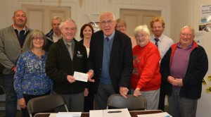 Photo of donation cheque to St John's Ambulance